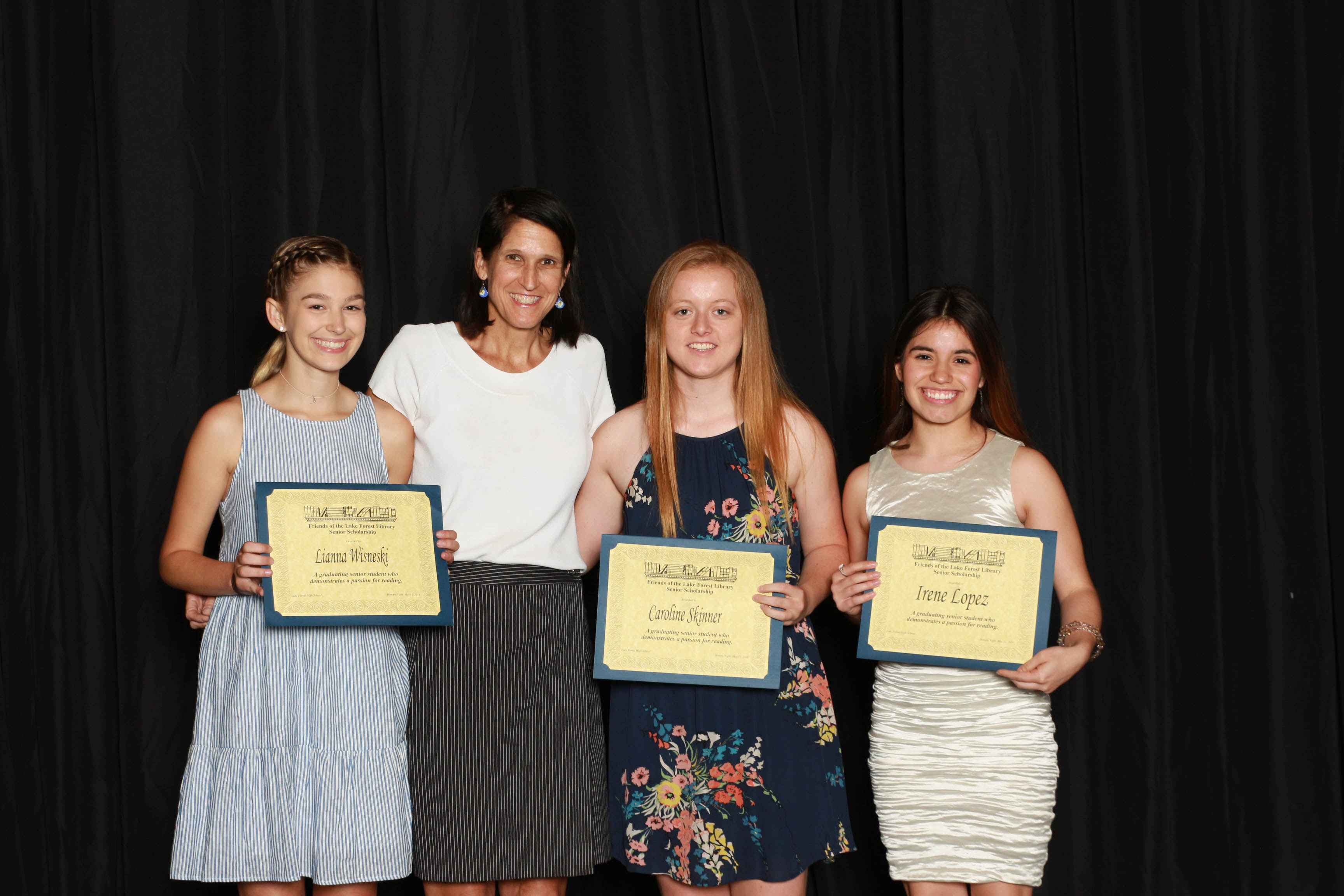 2018 Friends Scholarship recipients Lianna Wisneski, Caroline Skinner, and Irene Lopez with Friends Board Member Tish Borkowski Houston